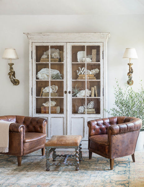Armoire with glass doors leather club chairs and wall sconces buy online from France French wedding present