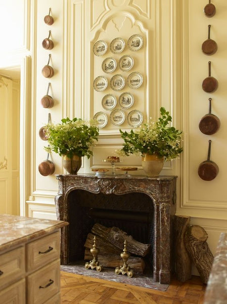Fireplace with Confit pots as vases