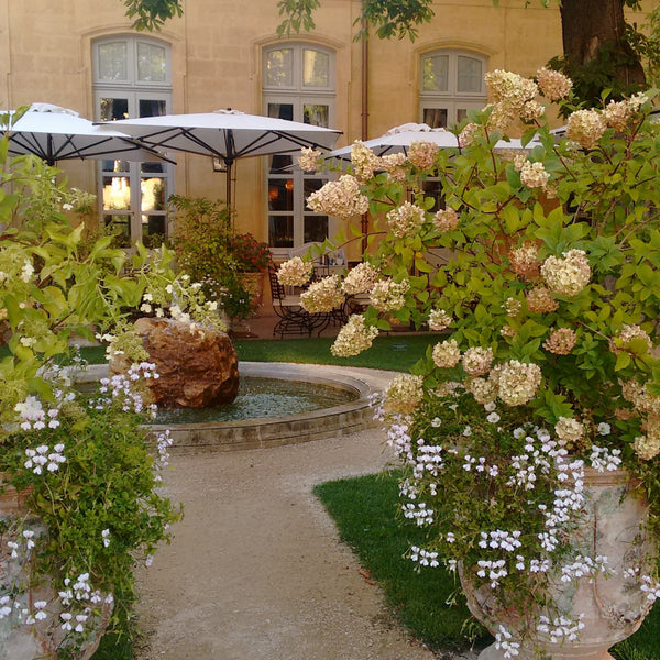 Anduze urns market umbrella patio garden terrace french Aix en Provence garden goals inspiration