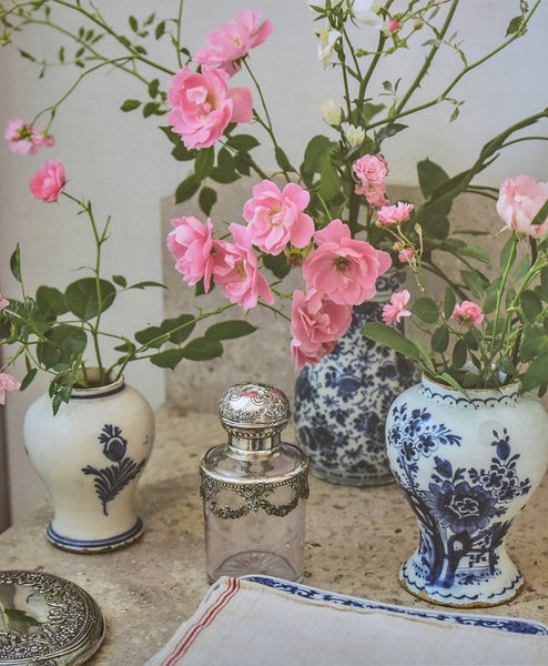Isabel López-Quesada antique vases with pink roses At Home book