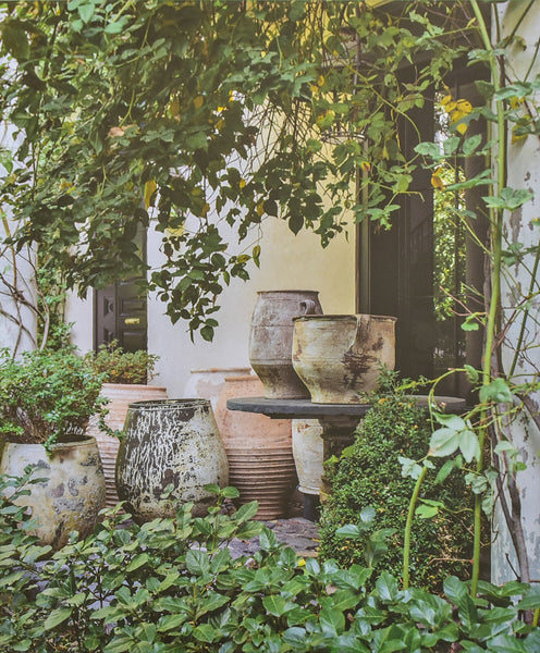Isabel López-Quesada At home - garden collection of antique oil jars and pots