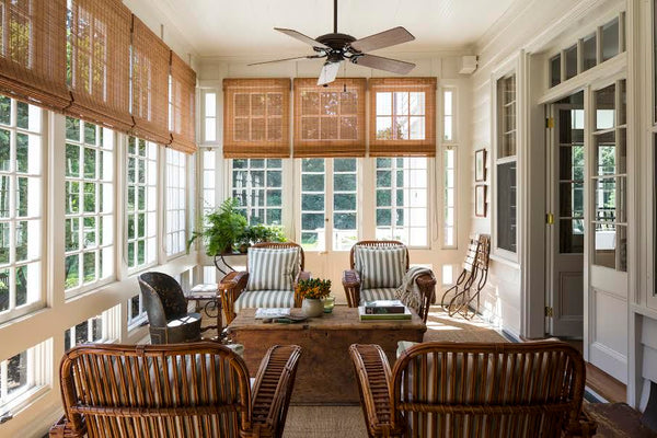 Living room with rattan chairs by Mark Cunningham