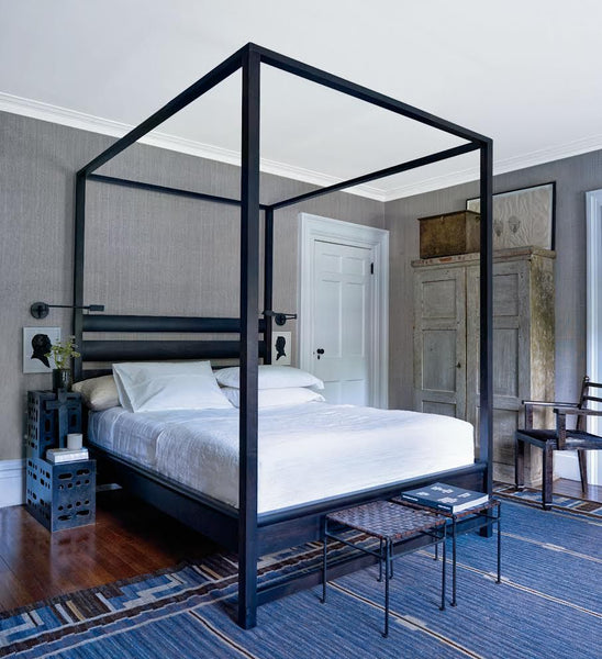 Bedroom with four poster bed and armoire