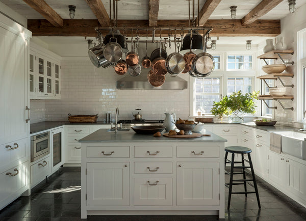 Modern farmhouse kitchen with copper pots and vintage stool - Mark Cunningham