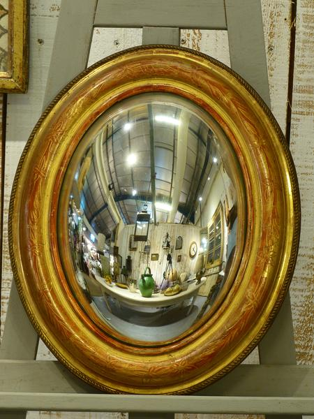 Oval French butlers mirror convex gilt frame