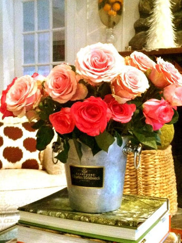 Vintage champagne bucket filled with roses