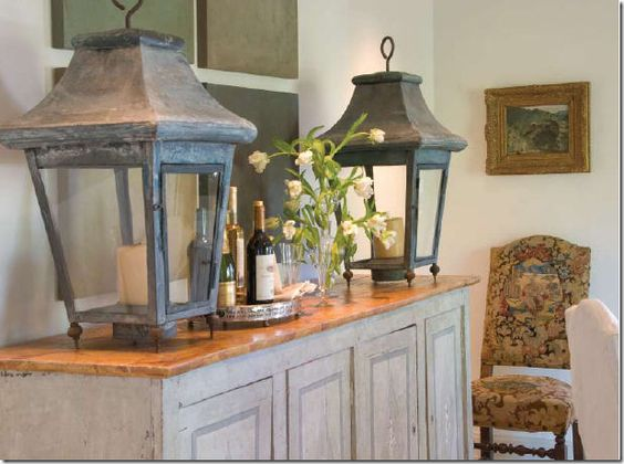 Pair of antique french lanterns on a console table