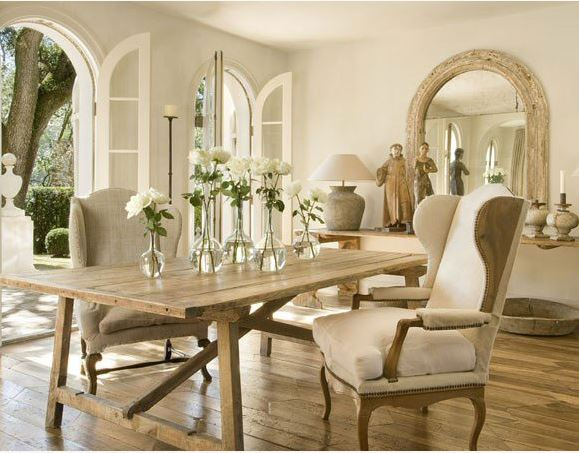 Rustic Farmhouse Table And Chairs In A Dining Space