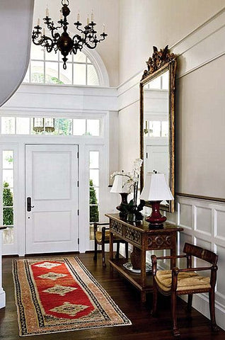 Entryway with antique gilt wood mirror