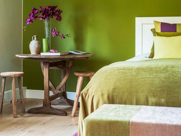 Folding vignerons table and rustic stools make practical and beautiful bedside tables - Walda Pairon