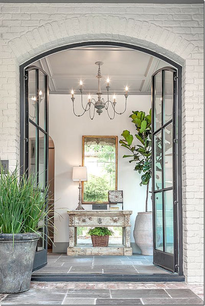 Entryway with gilt wood mirror lustre and french provincial console table