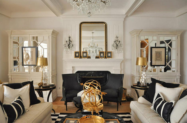 Living room with gold accents and antique Louis Philippe mirror on the mantle 2017 design trends