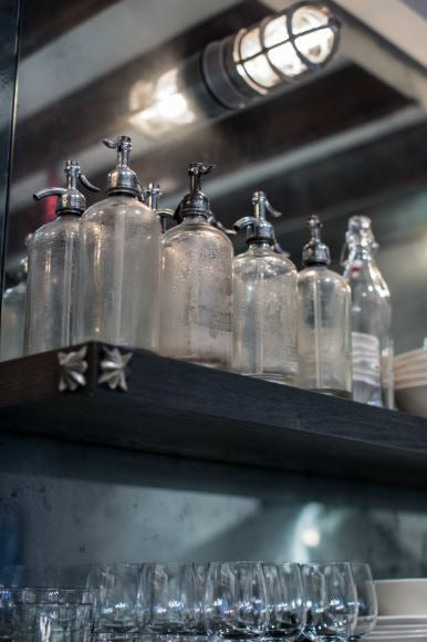 Jenny Wolf - Glass bottle collection in kitchen vintage glassware buy direct from France
