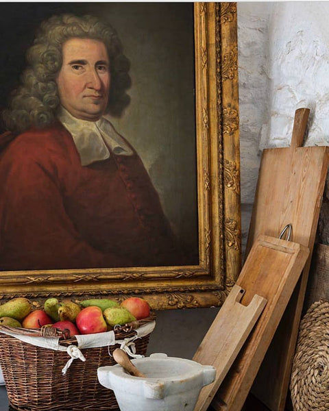 Marble mortar and pestle, antique portrait and cutting boards kitchen with antiques