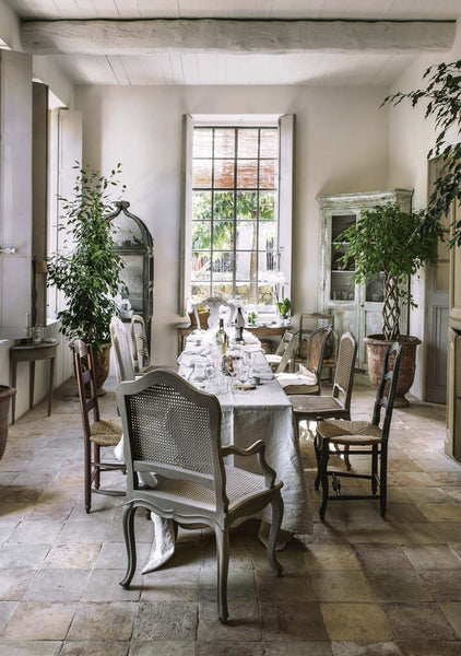 Garden room dining setting anduze urn and trees french doors