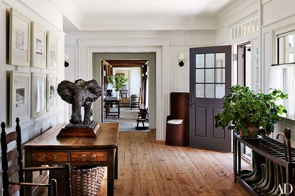Entry way with antique and vintage pieces by Mark Cunningham