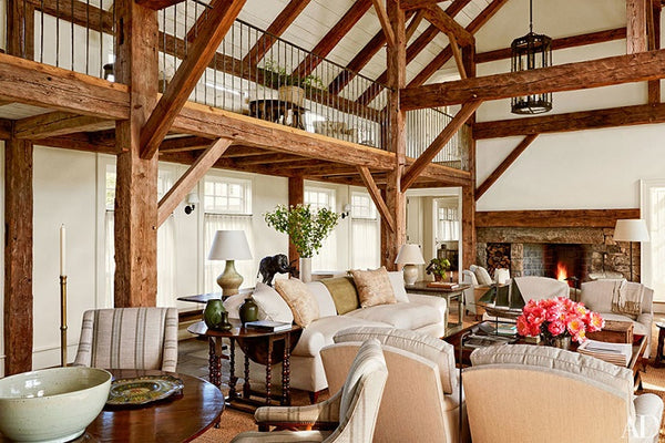 Living room with exposed timber beams and vintage finds by Mark Cunningham