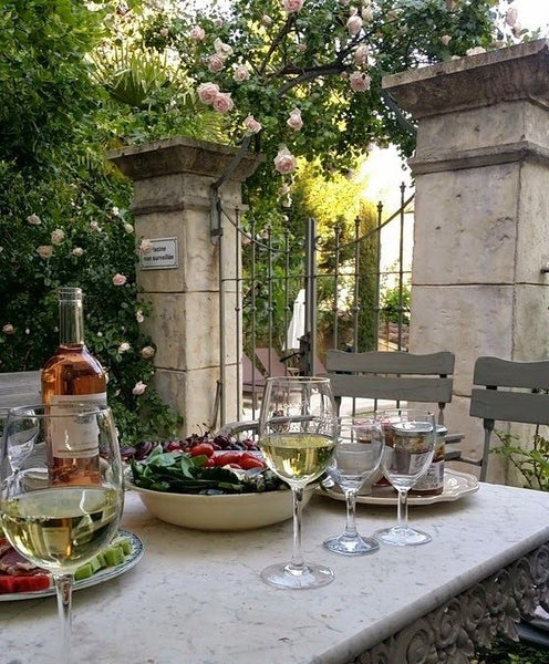 French lunch rose marble table outdoor luxury holidays summer Provence