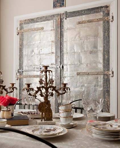 Jenny Wolf - Salvaged metal rustic doors candelabra chic dining room