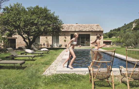 Vintage wicker chairs poolside in Provence Helmkampf