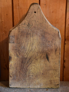 Antique French cutting board with curved handle