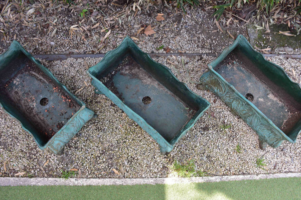 Two antique cast iron French garden planters with green finish