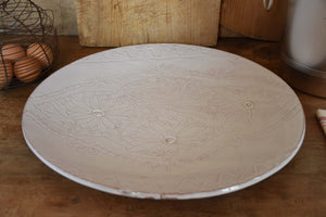 Large round platter with flower pattern