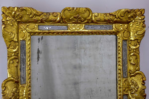 18th Century French mirror with gilded frame and aged glass
