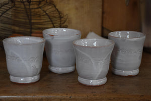 Set of four French artisan coffee cups