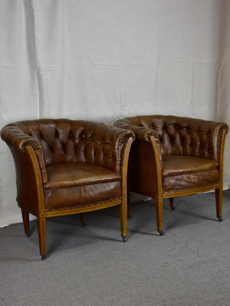 Pair of mid-century English leather armchairs
