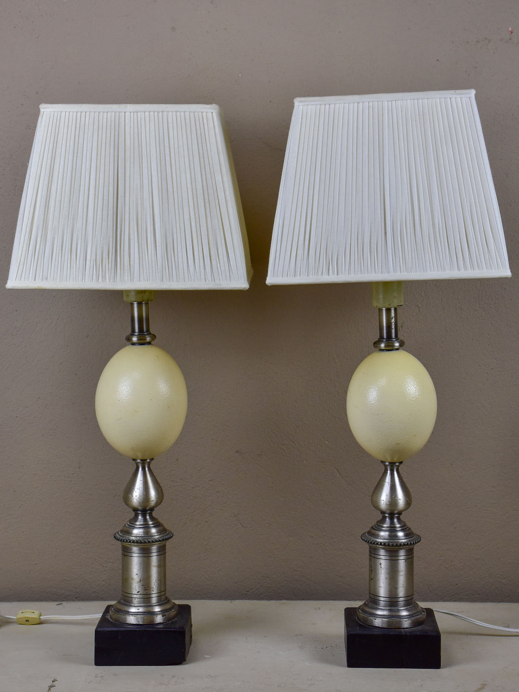 Pair of ostrich egg lamps with square lampshades