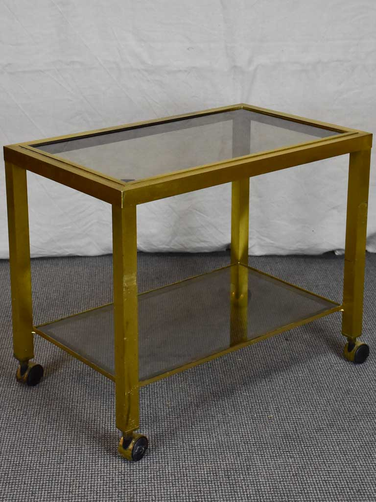 Mid century side table on wheels - glass and brass