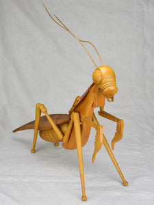Vintage wooden sculpture of a huge praying mantis