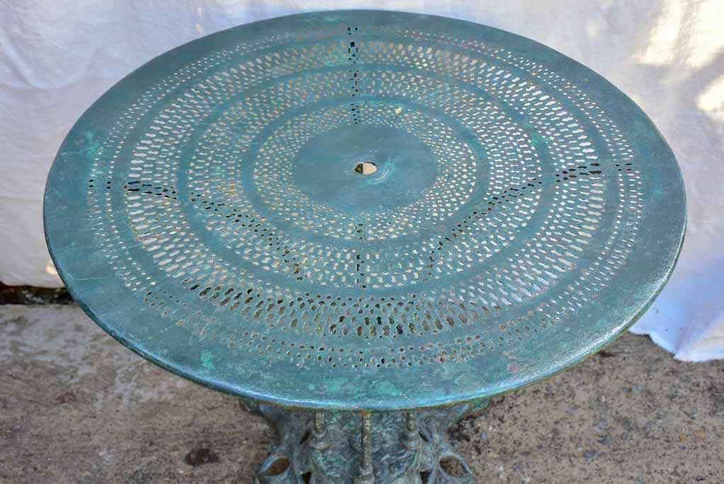 Antique Parisian garden table with three chairs - green