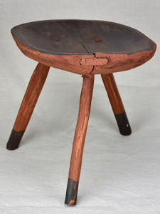 Antique French primitive milking stool with burgundy red paint finish