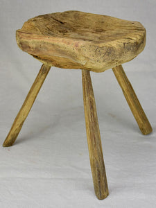 Timeworn antique French primitive milking stool