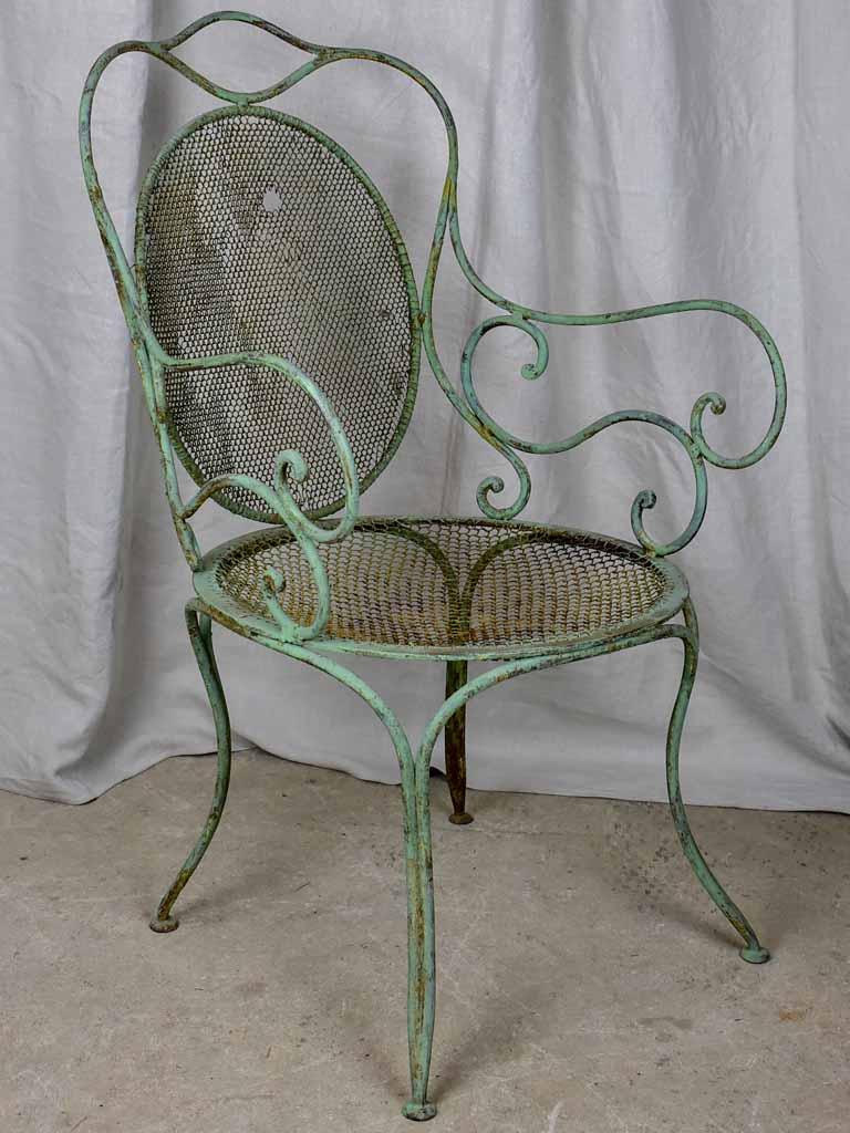 Antique French garden armchair with green patina
