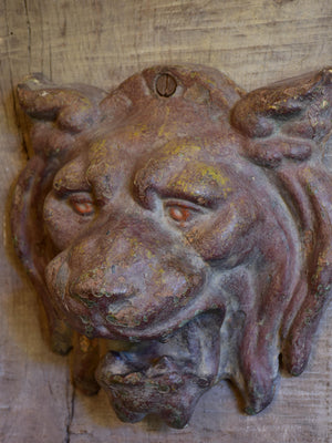 Mounted antique cast iron lion's head