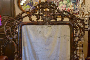 "Large late 18th Century carved wood mirror with original black patina and aged glass 45¾"" x 63½"""