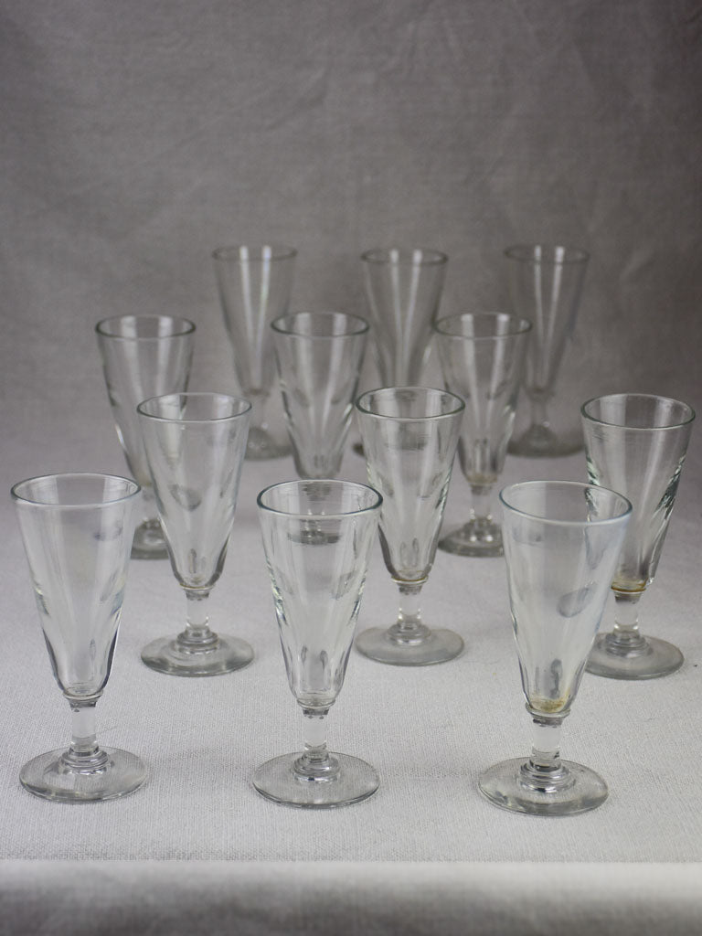 Rare set of 12 blown glass champagne flutes from the early 20th century