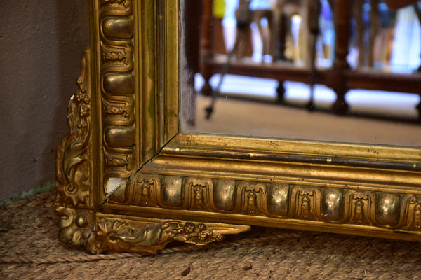 Antique French Regence mirror with gilded frame