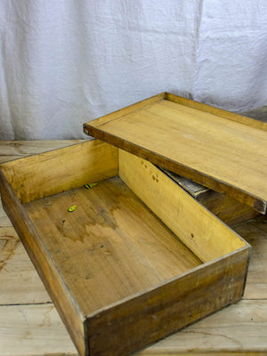 Collection of six large antique wooden boxes from a fabric boutique