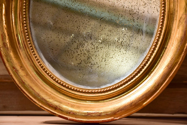 Mid-19th century oval Louis Philippe mirror