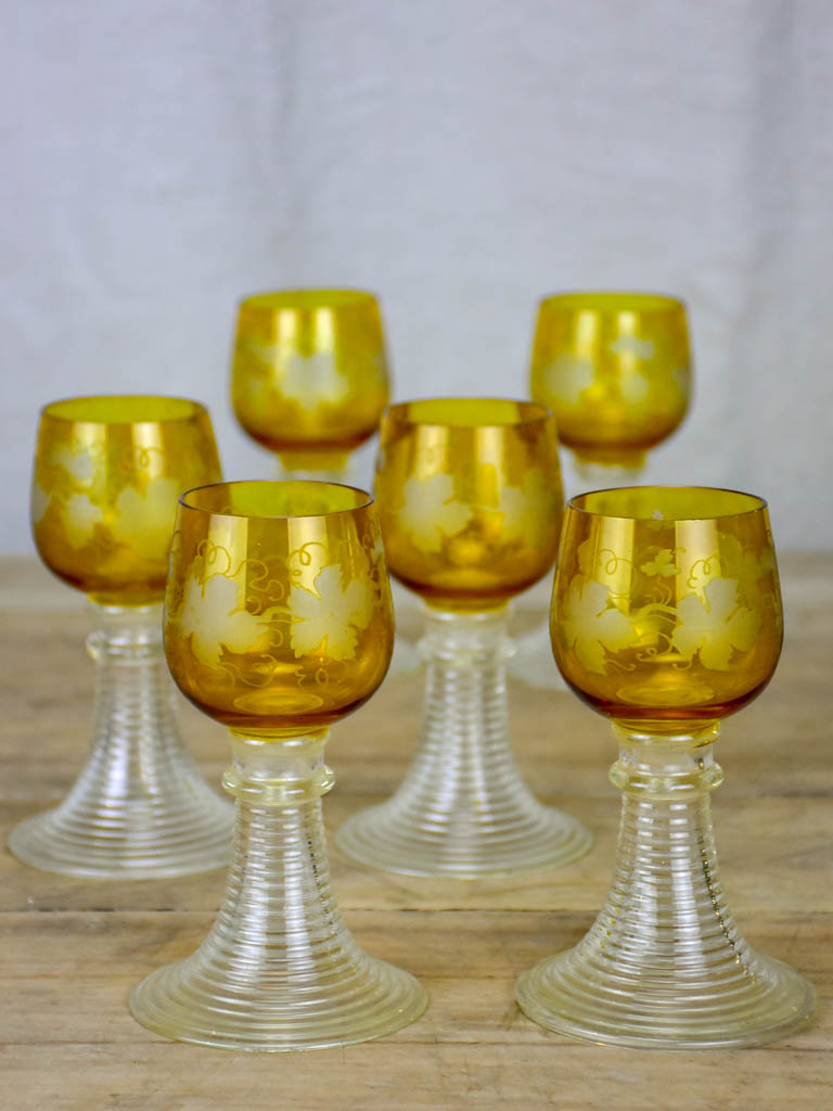 Six white wine glasses from Alsace with engraved decoration and broad ribbed bases
