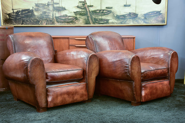 Pair of French leather club chairs with scroll back - pair one