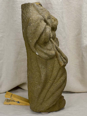 Medieval stone statue of a draped figure from Brittany