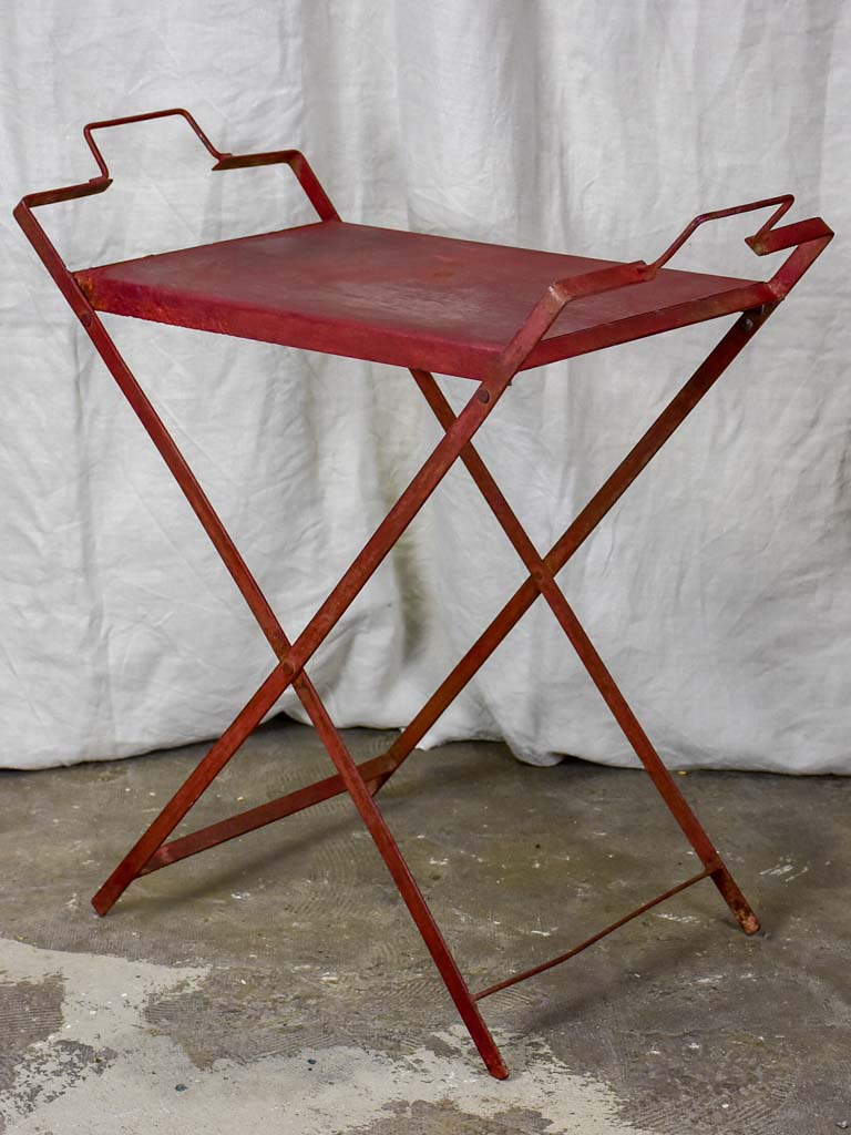 Red industrial French table made from salvaged materials