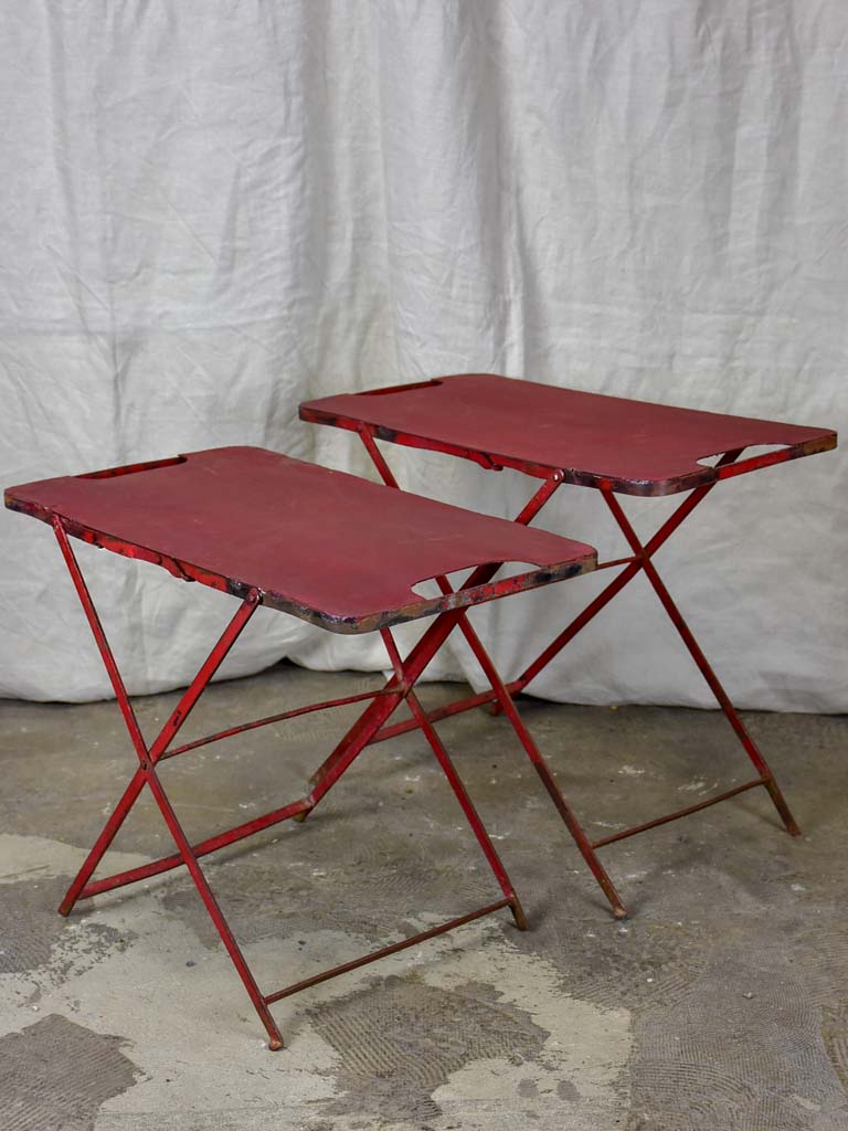 Two industrial French side tables - red