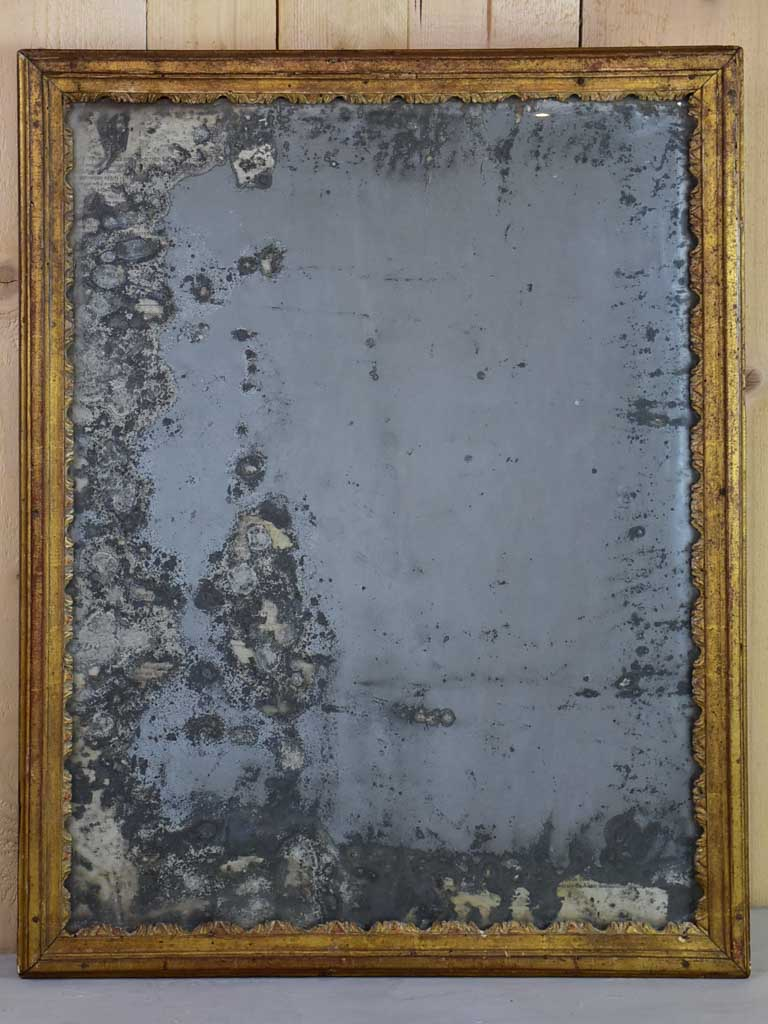 "Small nineteenth century French mirror with gilded frame and heavily aged glass 22½"" x 28¾"""