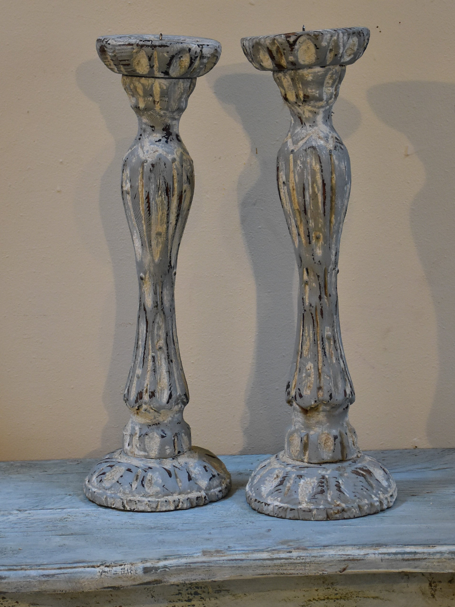 Pair of French candlesticks with white patina